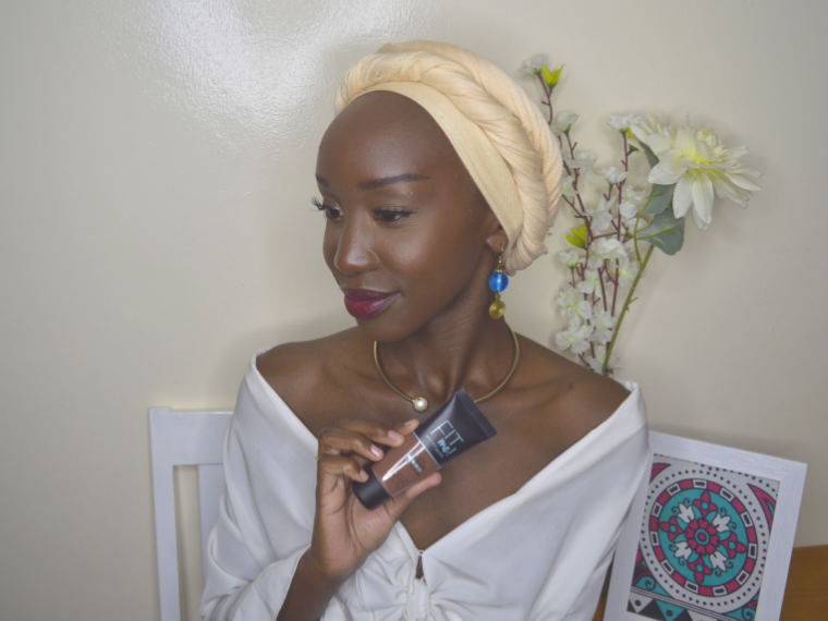 Dark Skin woman with Maybelline Fit Me 'Matte & Poreless' Foundation in Espresso 365